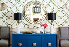 This bright, cheery room does lighting right: Twin lamps and sconces help soften overhead lighting.