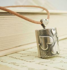 Leather and Sterling Silver Locket Necklace. $45.00, via Etsy.