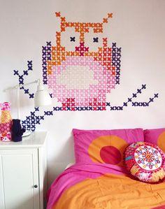 Awesome cross-stitched wall art!