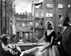 """James Stewart, Grace Kelly and Alfred Hitchcock on the set of """"Rear Window"""", 1954."""