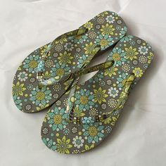 Vera Bradley Flip flops!NWOT Vera Bradley flip flops! New without tags! Still has size sticker in them! Such a fun pattern for spring and summer! Size M  7/8  lemon parfait is the pattern name! Vera Bradley Shoes Sandals