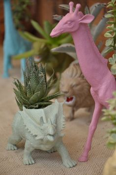 toy dinosaurs...so quirky and cheap for planters