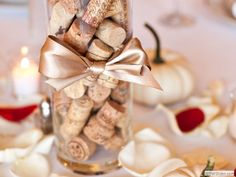 Wine Cork  Centerpiece with red rose pedals to surround it on the table. Perfect!