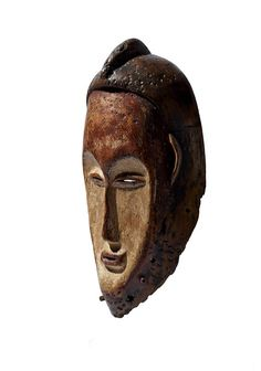 online.native-auctions.com Collected by C. Duponcheel during his journey in Gabon in the 1960's. Worn by itinerant troubadours and for hunting and punishing sorcerers. Typical large and elongated mask covered with kaolin and featuring a nice heart-shaped face with a long, fine nose.