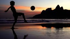 A young boy juggles a football on Ipanema Beach at RIO! http://www.1502983.talkfusion.com/es/products/