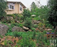 Boulder retaining wa