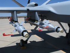 UAV dripping with armaments and support equipment