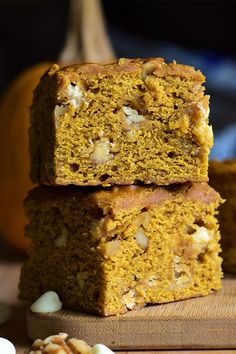 These white chocolate and walnut pumpkin bars are quick and easy dessert bars! Bake this pumpkin dessert using pumpkin pie spice, pumpkin puree, white chocolate chips, and walnuts. You will love baking this pumpkin recipe for a fall dessert or Thanksgiving! Pumpkin Bars, Pumpkin Dessert, Pumpkin Pie Spice, Baking Recipes, Cookie Recipes, Dessert Recipes, Desserts, Snack Recipes, Recipe Directions