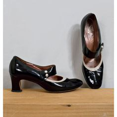 Vintage 1960s Black Patent Leather Mary Janes with Cream Leather Trim and Pearl Detail Buttons / Shoe Size 8 /45.00, via Etsy.