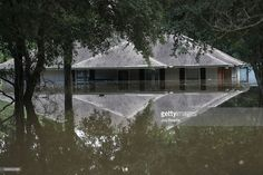 A flooded home is seen on August 15, 2016 in Baton Rouge, Louisiana. Record-breaking rains pelted Louisiana over the weekend leaving the city with historic levels of flooding that have caused at least seven deaths and damaged thousands of homes.