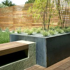 A nice feature of a slated wood fence is the ability to vary the dimensions of the slates. Heavier at the bottom while lighter and thinner at the top, this fence becomes an eye-catching architectural element in its own right.