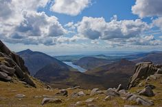 View from Summit of Slieve Bearnagh.  The Silent Valley Reservoir can be seen in the centre of the picture with Slieve Binnian to the Left and Slievenaglogh to the right.  To the fore are Ben Crom and Doan.