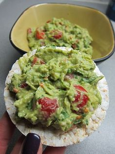 2 avocados, cherry tomatoes (quartered), big bunch of coriander (chopped finely), 1/2 shallot (diced finely), 2 tsp of lemon, a sprinkle of chilli flakes, salt and pepper. On a rice cake.