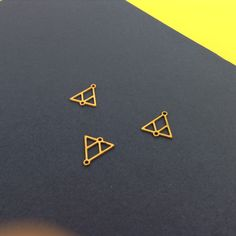 Gold Plated Triangles, Triangular V-Shaped Charms, Geometric Jewelry, 3 Pc ,Laser Cut Charms, Exclusive at Goldie Supplies, Minimalist by GoldieSupplies on Etsy https://www.etsy.com/listing/204150005/gold-plated-triangles-triangular-v