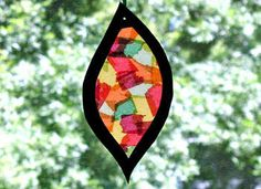 """My first graders did a similar project in art class - """"stained glass windows"""" on plastic with tissue paper, glue/water, and black paper. I want to make one for my window!"""