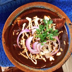 Playa Zicatela, Mexico   Oaxacan enchiladas, thick black bean and a little chocolate sauce, avocado, fresh cheese