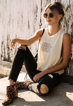 Top saved style inspiration for rocker booties include pairing printed booties with ripped denim and lived-in graphic T's.