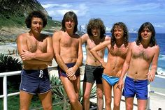 Hard rock group AC/DC at the beach in Ipanema Brazil during a South American tour January 1985 Left to right Brian Johnson Cliff Williams Simon. Angus Young, Ac Dc Rock, Rock In Rio, Bon Scott, Rock And Roll, Phil Rudd, Heavy Metal, Rio Festival, Ac Dc Band