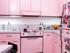 pink kitchen, I know this is not for everyone, but I would love to have white cabinets, and all pink appliances.