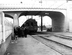 This photograph depicts a Pacific Electric Railway Company three-car train headed by car no.989 on the Venice Short Line at Vineyard as seen looking West, circa 1945