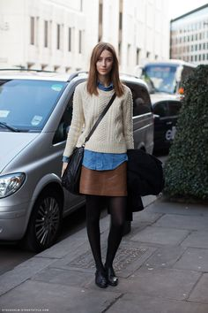 How to Style a Chunky Knit Sweater - cream sweater over chambray shirt + leather mini skirt, black tights and oxford shoes | StyleCaster