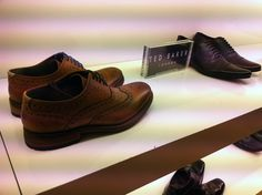High end price range. Ted Baker Men's shoes £130. Clearly labelled and identified as Ted Baker. Minimalistic visual merchandising.helping to create its high end appeal.