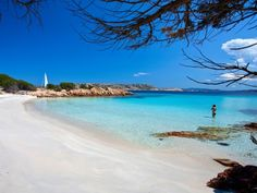 Located on Isola di Spargi in the Maddalena Archipelago, Cala Granara could almost be mistaken for a tropical Tahitian beach. It's not flanked by dramatic cliffs like many Italian beaches; instead, it's backed by palms and lush island plants. The shallow turquoise waters are perfect for snorkeling and the silvery sand begs for sunbathers.