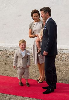 Prince Frederik and Princess Mary with Pincess Isabella and Prince Christian attend the Christening of Prince Henrik Carl Joachim Alain of Denmark at Mogeltonder Church on July 26, 2009 in Mogeltonder, Denmark.