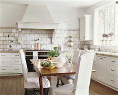 white kitchen with farm table designer