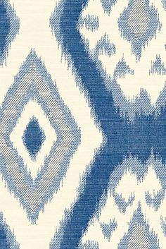 The Tybee Blue Fabric by the Yard features an ivory and blue Ikat diamond medallion pattern printed on a soft cotton blend.