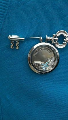For those of you who don't wear a lot of jewelry, consider adding your locket to a broach.  #origamiowl #fleurdelislockets www.facebook.com/fleurdelislockets.com