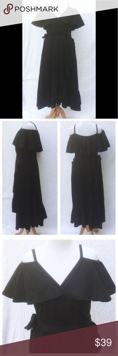 "New Eshakti Boho Black Ruffle Midi Dress XL 16 New Eshakti black knit ruffle midi dress XL 16 Measured flat: Underarm to underarm: 38"" Waist: 33-38"" Length: 41 & 52"" Eshakti size guide for XL 16 bust: 41 1/2"" Off-shoulder ruffle, surplice bodice, seamed elastic waist. Wrap high low skirt w/side ruffle & ruffled hem. Cotton/spandex, woven jersey knit, light stretch, mid-weight. Machine wash. New w/cut out Eshakti tags to prevent returning to Eshakti eshakti Dresses High Low"