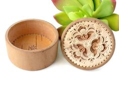 This is a small wooden carved floral design stash box for rings or small trinkets. Measurements: A little under 2 inches in diameter x 1.25 inches tall.  Condition: Great! Very little wear. Some fine scratches or scuffs.  Browse all of my home decor items here: https://www.etsy.com/shop/BunnyFindsVintage?ref=hdr_shop_menu&section_id=15169684  Dont forget to visit my shop home page for a coupon code and a variety of vintage treasures: https://www.ets...