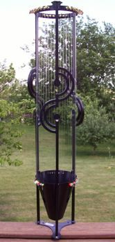 (I think the fairies invented this;) Aeolian harp.. the wind plays across the strings and makes beautiful music.