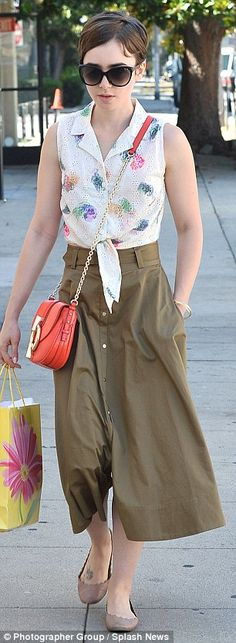 Lily Collins dons same green midi skirt she wore only two days earlier #dailymail