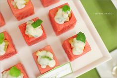Watermelon salad-beautiful cubes with hole scooped from center and filled with salad ingredients -a combination of diced grapes and apple & dressed with a yogurt dressing