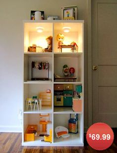 DIY IKEA DOLLHOUSE BOOKCASE:   We love how this simple Ikea bookcase was transformed into a dollhouse, complete with installed lighting! While the original bookcase used here has been discontinued, Ikea's Expedit bookcase will work just as well. Plus, when your child grows up, the bookshelf can go back to being just that.