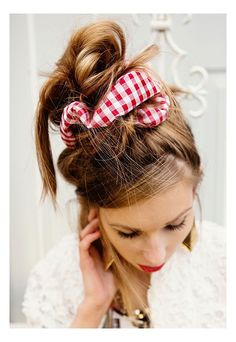 Scrunchie Styles That Won't Make You Feel Stuck in the 90′s | Beehive Hero: Wrap chubby scrunchie twice around a scruffy bun on the tip-top of your head. Steer clear of low ceilings.