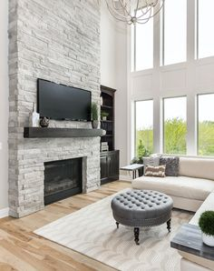 The 'Bailey' by Roeser Homes is an exceptional plan that offers plenty of space for the entire family. Fireplace Tv Wall, Grey Fireplace, Fireplace Remodel, Living Room With Fireplace, Fireplace Design, Ledger Stone Fireplace, Corner Stone Fireplace, White Stone Fireplaces, Two Story Fireplace