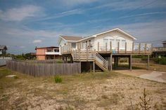 "Listen to the sounds of the ocean ""Beach Music"" from the deck of this beachy summer cottage. Just a short walk to Little Island Park, where you will enjoy tennis, fishing, and a life guarded beach...."