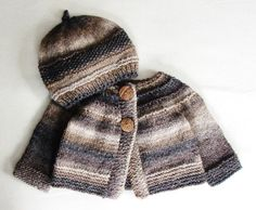 This sweater will fit babies 6 to 9 months old.    Hand knitted from wool blend yarn in natural tones of brown, taupe, gray and cream, this