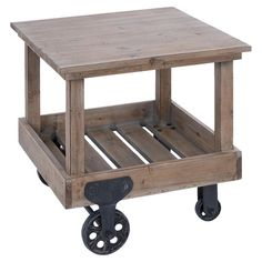 Cart-style side table with a lower slatted shelf and wheels.    Product: Side tableConstruction Material: Wood ...