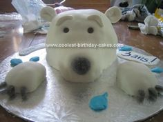 Homemade Polar Bear Birthday Cake: I made this Polar Bear Birthday Cake for my 3 year old son's birthday. I used a round Pyrex container to build the main head part and some muffins for i thought id pin this for a friend of mine who was looking for something creative to do