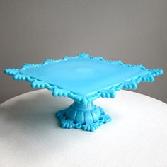 FAB FAB FAB! Westmoreland Blue Milk Glass Cake Stand - Square - Petal and Ring - Wedding Cake Stand. $425.00, via Etsy.