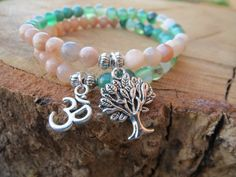 Check out this item in my Etsy shop https://www.etsy.com/listing/238678560/tree-of-life-om-charm-bracelet-zen