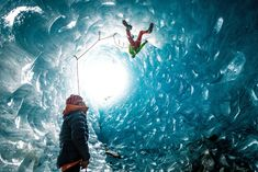 Ice climbers work their way up a shaft inside a glacier in the French Alps in this National Geographic Your Shot Photo of the Day.