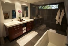 Bathroom with gorgeous bathroom tiles and glass shower enclosure.