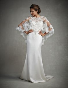 Style * JASMINE * » Enzoani 2015 Collection » by Enzoani » Available Colours : Ivory/Ivory, White/White ~ Shown off the Shoulder Neckline with with delicate Sheer Lace Overlay. A low V-Back with detachable Silver Chains draped across.