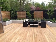 Family garden uses Garapa hardwood decking for durability