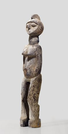A fragmentary Lobi sculpture of a well known carver